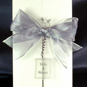 Centre opening wedding invitations dont just have to have a bow! This one as a personalised handmade ornament as well!